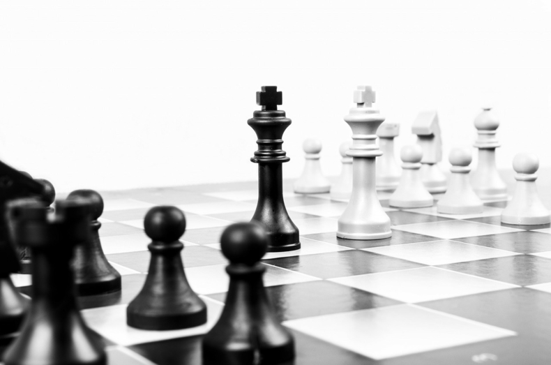 Chess pieces in conflict