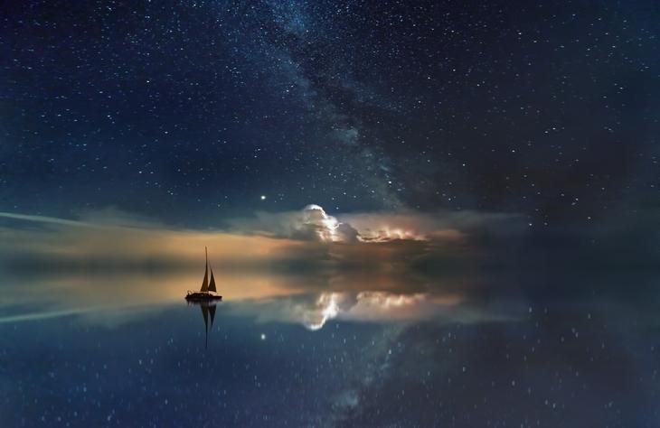 A sailing boat on placid sea