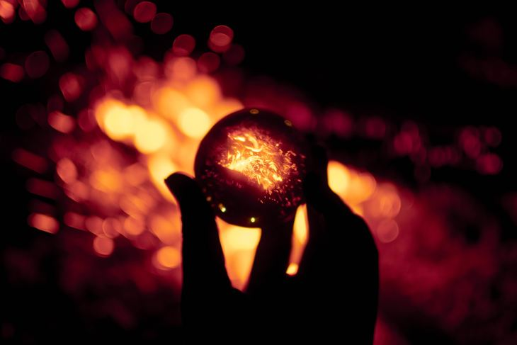 A glass ball reflecting fire