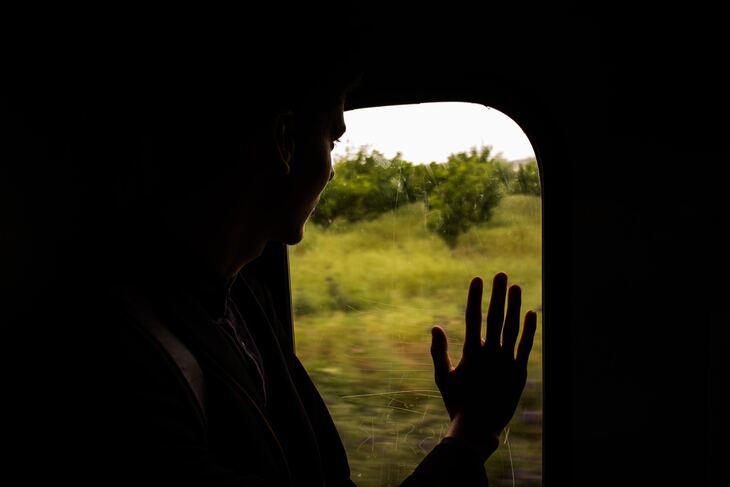 Hand on a window
